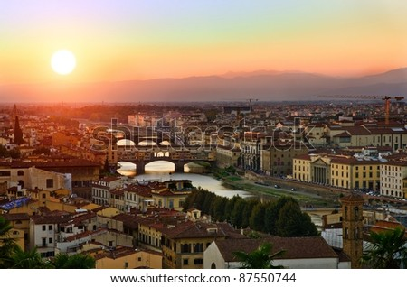 Panoramic view to sunset bridges above Arno river, Florence, Tuscany, Italy - stock photo