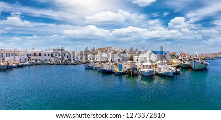 Panoramic view to the idyllic fishing village Naousa with moored traditional fishing boats on the island of Paros, Cyclades, Greece Foto d'archivio ©