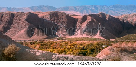 Panoramic view to the 37 kilometers long  Serdar Health Path in valley within the Kopet Dag Mountains in background.  Stockfoto ©