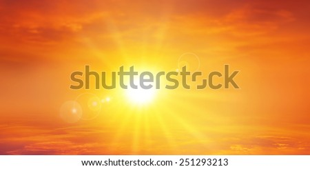 Stock Photo Panoramic warm sunset. High resolution sky background with a radiant setting sun