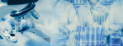 Panoramic web banner of microscope in a medical research lab or science laboratory, study for making vaccine to protection a coronavirus COVID-19