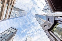 Panoramic wide angle view and perspective to steel light background of glass high rise buildings. Causeway Bay, Hong Kong Island.