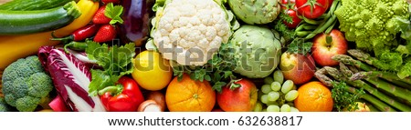 Panoramic wide organic food background concept with full frame pile of fresh vegetables and fruits mix forming bright colorful image #632638817