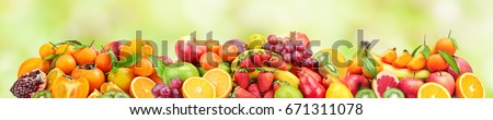 Panoramic wide photo of fresh fruits for skinali on a blurred green background