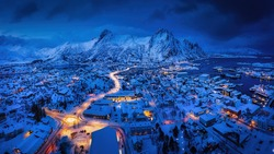 Panoramic winter view of Svolvaer in the night, Lofoten Islands, Norway. Blue hour winter view.