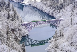 Panoramic Winter View of Tadami Railway Line And Bridge Reflection in The Valley of Tadami River, Mishima Machi, Aizu, Fukushima, Japan