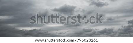 Panoranic gray overcast sky. Beautiful cloudscape over horizon, sky.