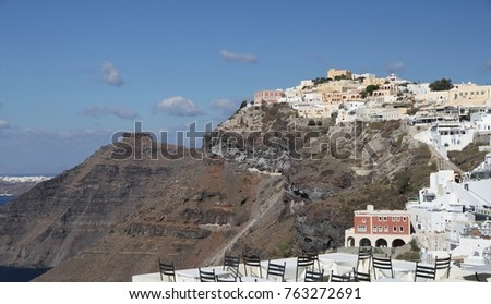 Panormaic view of the city of Fira with its cubiform buildings on Santorini Island, Greece. #763272691