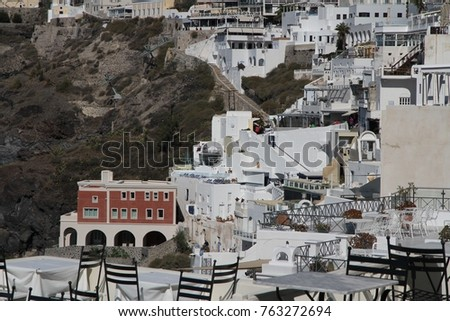Panormaic view of the city of Fira with its cubiform buildings on Santorini Island, Greece. #763272694