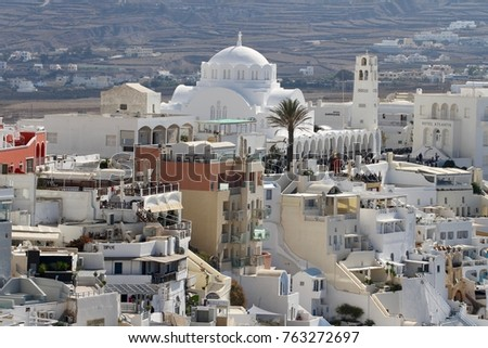 Panormaic view of the city of Fira with its cubiform buildings on Santorini Island, Greece. #763272697