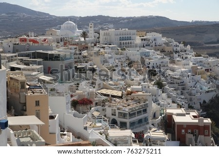 Panormaic view of the city of Fira with its cubiform buildings on Santorini Island, Greece. #763275211