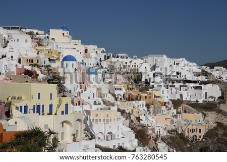 Panormaic view of the city of Fira with its cubiform buildings on Santorini Island, Greece. #763280545