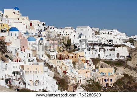 Panormaic view of the city of Fira with its cubiform buildings on Santorini Island, Greece. #763280560