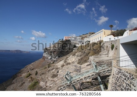 Panormaic view of the city of Fira with its cubiform buildings on Santorini Island, Greece. #763280566
