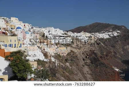 Panormaic view of the city of Fira with its cubiform buildings on Santorini Island, Greece. #763288627