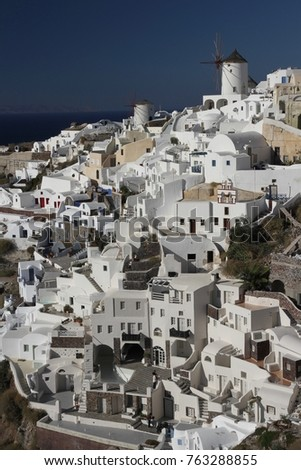 Panormaic view of the city of Fira with its cubiform buildings on Santorini Island, Greece. #763288855