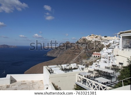 Panormaic view of the city of Fira with its cubiform buildings on Santorini Island, Greece. #763321381