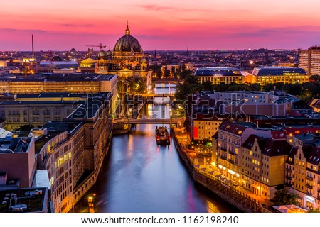Panoromic  aerial view of Berlin skyline with famous TV tower and Spree river in beautiful post sunset twilight during blue hour at dusk with dramatic  colorful clouds , central Berlin Mitte, Germany #1162198240