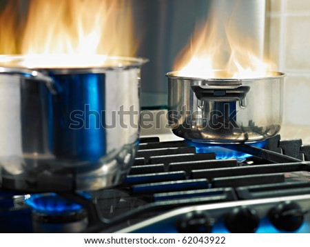 pans in fire on stoves. Horizontal shape