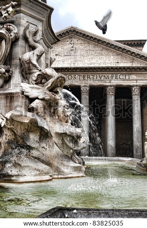 Pantheon and a near fountain and a flying dove in Rome, Italy - stock photo
