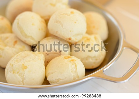 Pao de Queijo Mineiro - Brazilian cheese buns from Minas. Close-up. Shallow DOF.