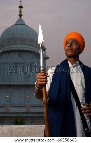 PAONTA SAHIB - MAY 22: A young Sikh man brandishing a spear at the Paonta Sahib Gurudwara, famous for its past warriors May 22, 2009 in Paonta Sahib, Himachal Pradesh, India