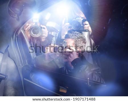 Paparazzi taking pictures through car window Stock foto ©