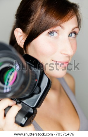 Paparazzi woman taking picture with photo camera