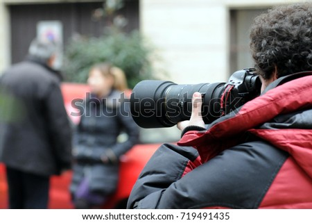 Paparazzo - Paparazzi - man taking pictures scoop -