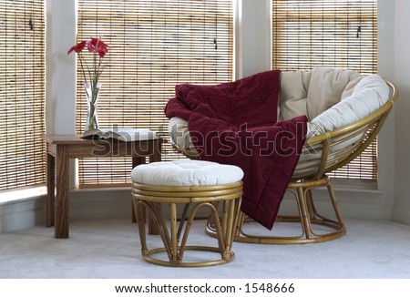 papasan chair with stool, coffee table and flowers