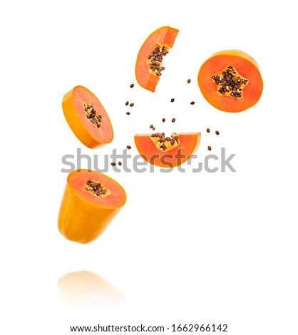 Papaya fruit flying in air, minimal. Tropical exotic orange summer sweet fresh papaya. Colorful levitation concept. Falling fly cut slice orange papaya, fruity creative vivid design Stockfoto ©