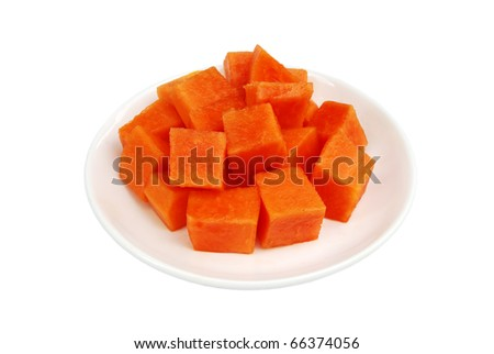 Papaya fruit in dish on white background.