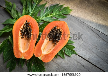 Papaya fruit on wooden background. Stockfoto ©