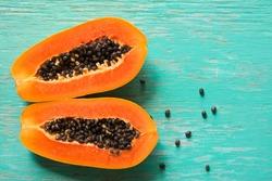 Papaya fruit on wooden background.Slices of sweet papaya on wooden background,Halved papayas