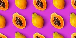 Papaya fruit seamless pattern on purple background, flat lay, top view