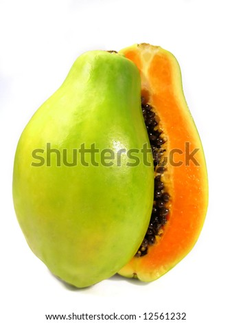 Papaya fruit section sliced on half isolated on a white background.