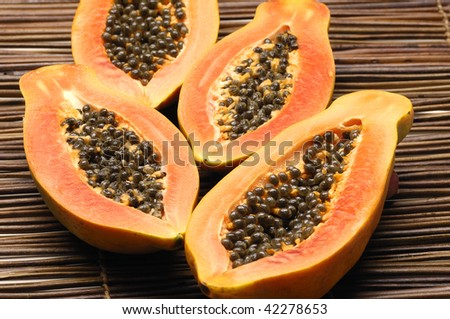 Papaya fruit sliced on half