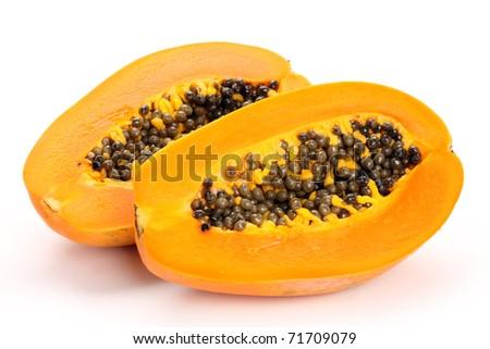 Papaya fruit sliced on half isolated on a white background.