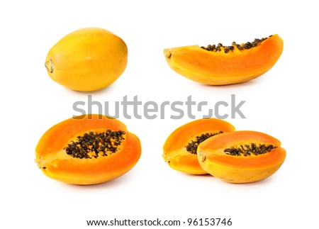Papaya fruit sliced on half isolated on a white background.