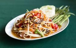 Papaya Salad Thai style (Som tum ) serve with fresh grees vegetable