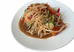 Papaya Salad with Fermented Fish in White Dish isolated on a white background.no focus