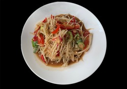 Papaya Salad with Fermented Fish in White Dish on a black background.no focus