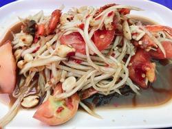 Papaya salad with salted crab and fermented fish or Somtum Korat in Thai street food