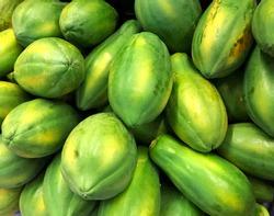 Papaya stand on the market - papaya fruit