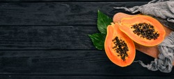 Papaya. Tropical Fruits. On a wooden background. Top view. Copy space.