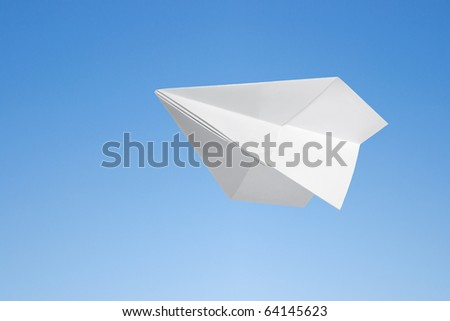 Paper airplane against the blue sky