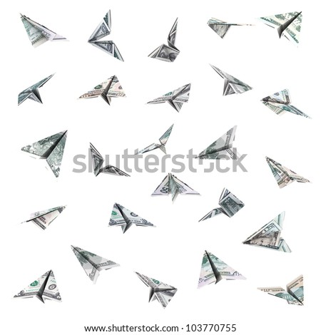 Paper airplanes from the dollar bills, isolated on white background.