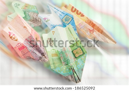 Paper airplanes of Ukrainian money