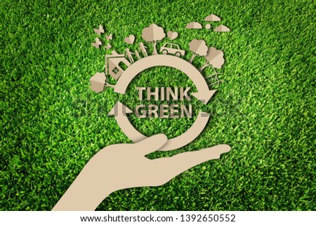 Stock Photo Paper art style of eco on green grass background. Save the earth.