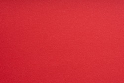 Paper background red color. Rough paper texture. Closeup. Macro